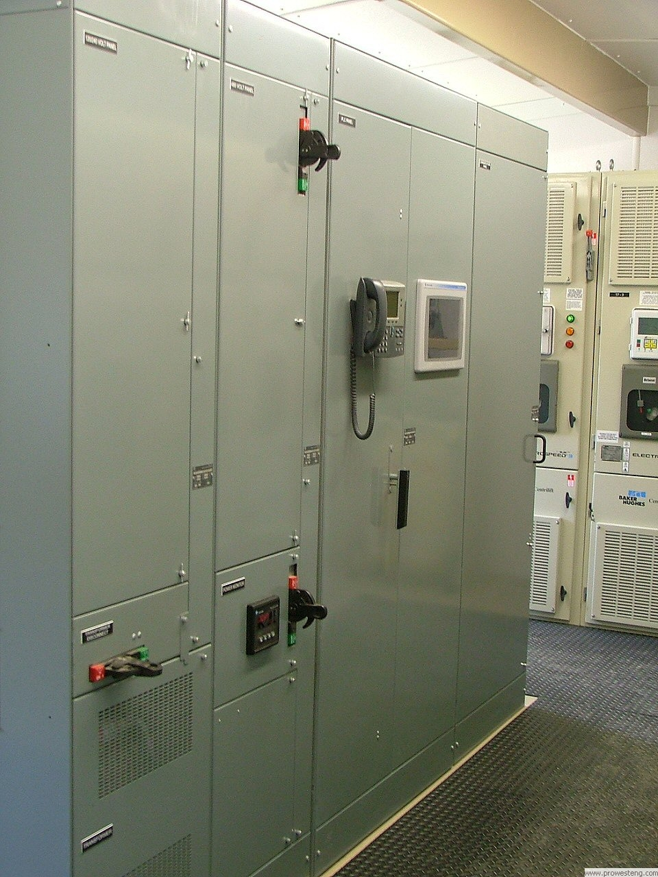 Low Voltage Motor Control Center line-up with integrated PLC control panel and communications equipment.